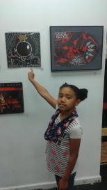 Frida pointing at her piece